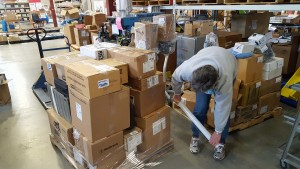 Barb Youngberg preparing our HWHL laboratory equipment and supply pallet to be shipped